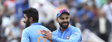 India's captain Virat Kohli, right, celebrates with teammate Jasprit Bumrah after their win over Bangladesh in the Cricket World Cup match at Edgbaston in Birmingham, England, Tuesday, July 2, 2019. (AP Photo/Aijaz Rahi)