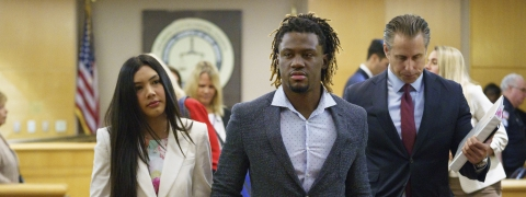 Philadelphia Phillies baseball player Odubel Herrera leaves a courtroom with an unidentified friend after a hearing on a domestic violence case in Atlantic City, N.J., Wednesday, July 3, 2019. (Jessica Griffin/The Philadelphia Inquirer via AP, Pool)