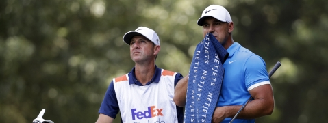Brooks Koepka prepares to hit on the third fairway during the final round of the World Golf Championships-FedEx St. Jude Invitational, Sunday, July 28, 2019, in Memphis, Tenn. (AP Photo/Mark Humphrey)