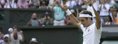 Switzerland's Roger Federer celebrates defeating Japan's Kei Nishikori during a men's quarterfinal match on day nine of the Wimbledon Tennis Championships in London, Wednesday, July 10, 2019. (AP Photo/Tim Ireland)