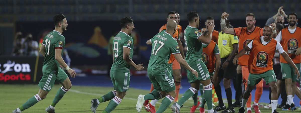 Algerian players celebrate after a goal during Group C match with Senegal on June 27 (Hassan Ammar)