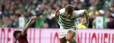 FK Sarajevo's Benjamin Tatar, left, and Celtic's James Forrest battle for the ball during the Champions League first qualifying round, second leg soccer match at Celtic Park, Glasgow, Scotland, Wednesday July 17, 2019.