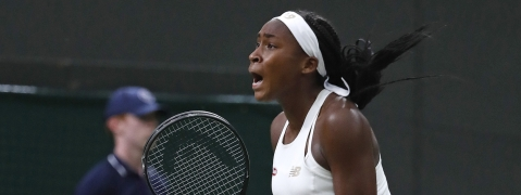 "United States' Cori ""Coco"" Gauff celebrates after beating Slovakia's Magdalena Rybaikova in a Women's singles match during day three of the Wimbledon Tennis Championships in London, Wednesday, July 3, 2019. (AP Photo/Alastair Grant)"
