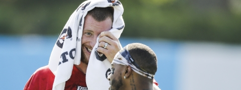 Philadelphia Eagles quarterback Carson Wentz, left, and wide receiver DeSean Jackson meet during practice at the NFL football team's training camp in Philadelphia, Friday, July 26, 2019.