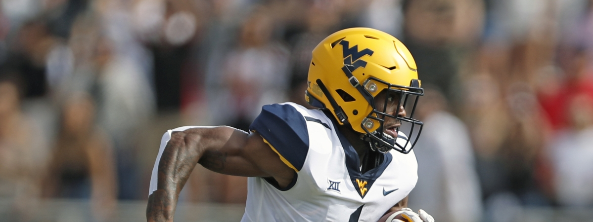 FILE - In this Sept. 29, 2018, file photo, West Virginia's T.J. Simmons runs downfield with the ball during the first half of the team's NCAA college football game against Texas Tech in Lubbock, Texas. Simmons is the top returning wide receiver on a unit that lost most of its production from last season. (AP Photo/Brad Tollefson, File)