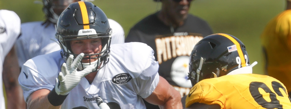 FILE - This Aug. 1, 2019, file photo shows Pittsburgh Steelers tight end Vance McDonald (89) as he battles linebacker Ola Adeniyi (92) during practice at their NFL football training camp in Latrobe, Pa. (AP Photo/Keith Srakocic, File)
