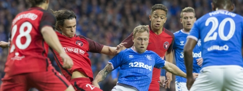 Rangers Scott Arfield, centre, in action against Danish team Midtjylland players during their Europa League Third Qualifying Round Second Leg soccer match at Ibrox Stadium in Glasgow, Scotland, Thursday Aug. 15, 2019. (Jeff Holmes/PA via AP)