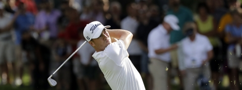 Justin Thomas watches his second shot on the 18th hole during the final round of the BMW Championship golf tournament at Medinah Country Club, Sunday, Aug. 18, 2019, in Medinah, Ill. He finished under 25. (AP Photo/Nam Y. Huh)