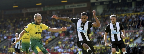 Norwich City's Teemu Pukki, left, has a shot on goal during the English Premier League soccer match between Norwich City and Newcastle United, at Carrow Road, in Norwich, England, Saturday, Aug.17, 2019.