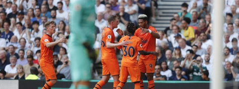 Newcastle's Joelinton, right, celebrates after scoring his side's first goal during the English Premier League soccer match between Tottenham Hotspur and Newcastle United at Tottenham Hotspur Stadium in London, Sunday, Aug. 25, 2019.