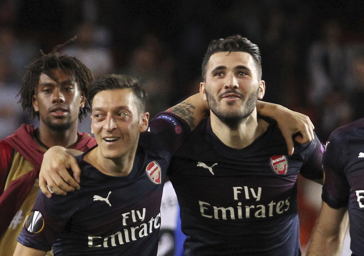 FILE - In this Thursday, May 9, 2019 file photo, Arsenal defender Sead Kolasinac, right celebrates with Arsenal midfielder Mesut Ozil, left, at the end of a Europa League semifinal soccer match. (AP Photo/Alberto Saiz, File)