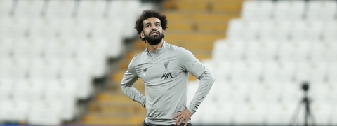 Liverpool's Mohamed Salah stretches during a training session at the Besiktas Park Stadium, in Istanbul, Tuesday, Aug. 13, 2019. The winners of Champions League, Liverpool and Europa League, Chelsea will play at the Super Cup soccer match on Wednesday.