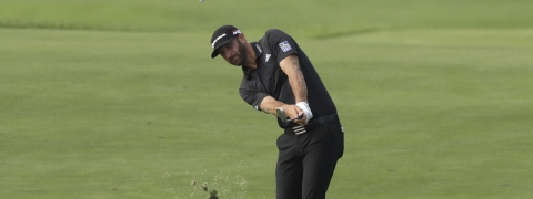 Dustin Johnson drives to the 12th hole in the Northern Trust tournament at Liberty National Golf Course, Thursday, Aug. 8, 2019, in Jersey City, N.J. (AP Photo/Mark Lennihan)