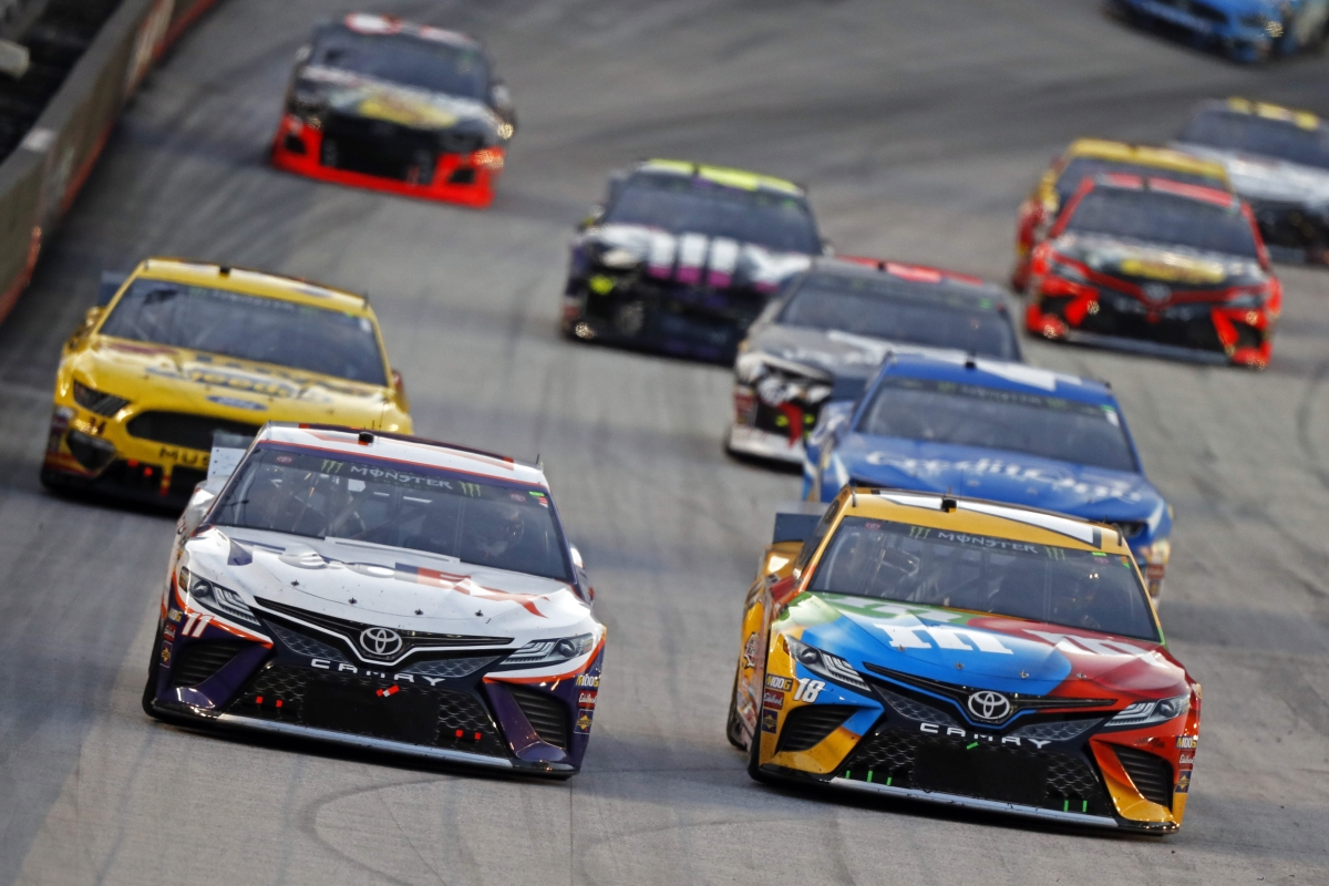 Denny Hamlin (11) leads Kyle Busch (18) and others down the straight during a NASCAR Cup Series auto race, Saturday, Aug. 17, 2019, in Bristol, Tenn. (AP Photo/Wade Payne)