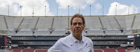 FILE - In this Aug. 3, 2019, file photo, Alabama head coach Nick Saban prepares for a team coach photo prior to Alabama's fall camp fan-day NCAA college football scrimmage at Bryant-Denny Stadium in Tuscaloosa, Ala.  (AP Photo/Vasha Hunt, File)