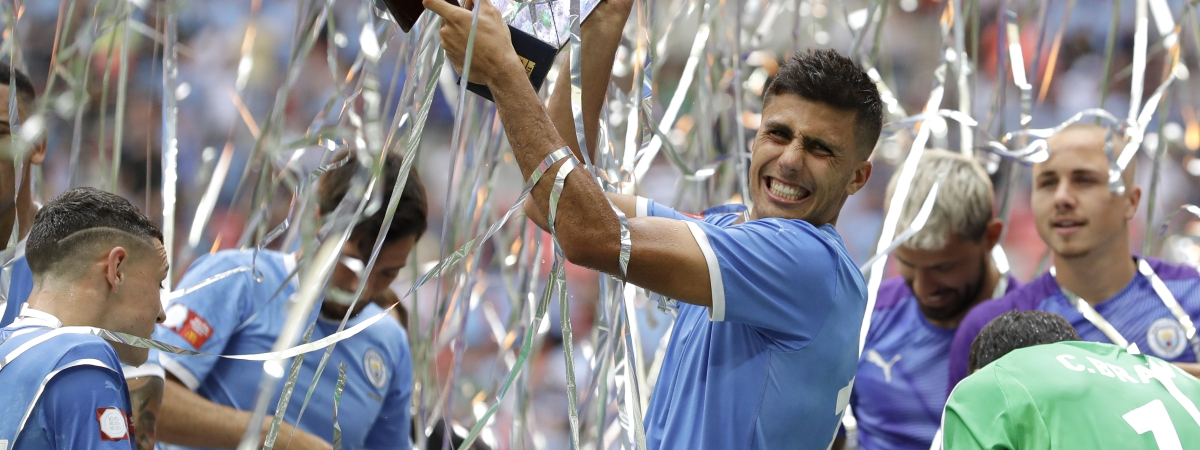 Manchester City's Rodri holds up the trophy after the English Community Shield soccer match between Liverpool and Manchester City at Wembley stadium in London, Sunday, Aug. 4, 2019.
