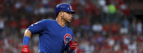 Chicago Cubs' Willson Contreras rounds first on a single during the third inning of a baseball game against the St. Louis Cardinals Wednesday, July 31, 2019, in St. Louis. (AP Photo/Jeff Roberson)