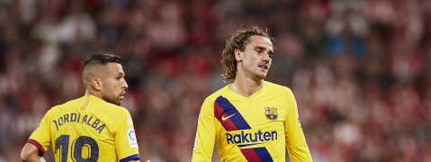 Barcelona's Antoine Griezmann, right, reacts during the Spanish La Liga soccer match between Athletic Bilbao and FC Barcelona at San Mames stadium in Bilbao, northern Spain, Friday, Aug. 16, 2019..