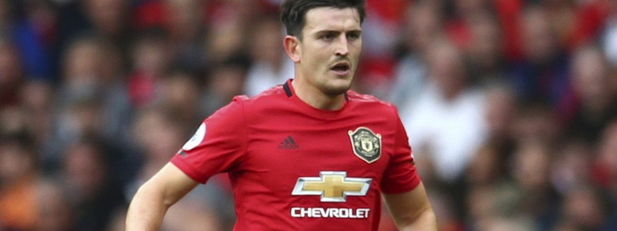 Manchester United's Harry Maguire controls the ball during the English Premier League soccer match between Manchester United and Chelsea at Old Trafford in Manchester, England, Sunday, Aug. 11, 2019.