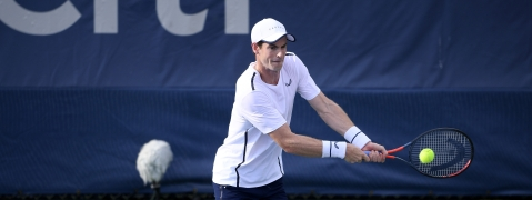 Andy Murray returns the ball as he and Jamie Murray, both of Britain, played a doubles match against Raven Klaasen, of South Africa, and Michael Venus, of New Zealand, in the Citi Open tennis tournament, Friday, Aug. 2, 2019, in Washington. (AP Photo/Nick Wass)