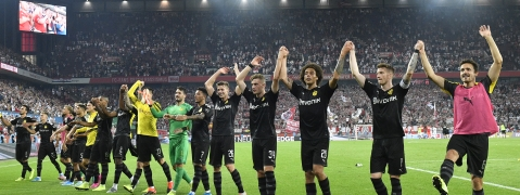 Borussia players celebrate at the end of the German Bundesliga soccer match between FC Cologne and Borussia Dortmund in Cologne, Germany, Friday, Aug.23, 2019. Borussia won 3:1. (AP Photo/Martin Meissner)