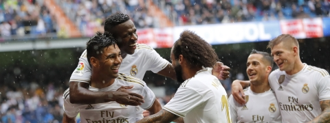Real Madrid's Casemiro celebrates with teammates after scoring his side's third goal during the Spanish La Liga soccer match between Real Madrid and Levante at the Santiago Bernabeu stadium in Madrid, Spain, Saturday, Sept. 14, 2019. (AP Photo/Bernat Armangue)
