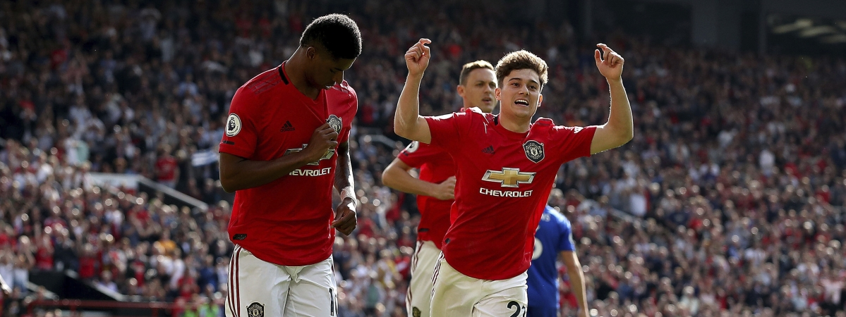 Manchester United's Marcus Rashford, left, celebrates scoring his side's first goal of the game from the penalty spot during the English Premier League soccer match between Manchester United and Leicester City at Old Trafford Stadium, Manchester England. Saturday, Sept. 14 2019.