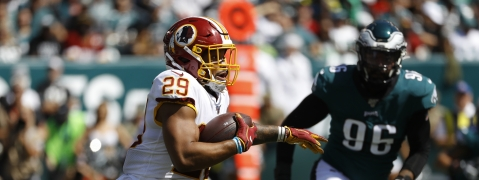 Washington Redskins' Derrius Guice, left, rushes during the first half of an NFL football game against the Philadelphia Eagles, Sunday, Sept. 8, 2019, in Philadelphia.