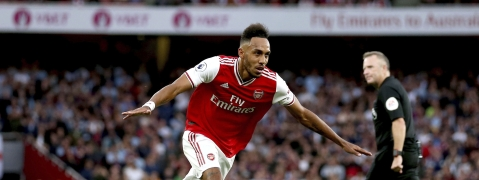 Arsenal's Pierre-Emerick Aubameyang celebrates scoring against Aston Villa during the English Premier League soccer match at the Emirates Stadium, London, Sunday Sept. 22, 2019.