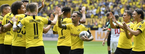 This photo, taken Aug.17, 2019, shows Dortmund's Paco Alcacer holding the ball as he celebrates after scoring his side's first goal during the German Bundesliga soccer match between Borussia Dortmund and FC Augsburg at the Signal Iduna Park stadium in Dortmund, Germany.