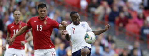 Bulgaria's Georgi Sarmov, right, tackles England's Raheem Sterling during the Euro 2020 group A qualifying soccer match between England and Bulgaria at Wembley stadium in London, Saturday, Sept. 7, 2019.