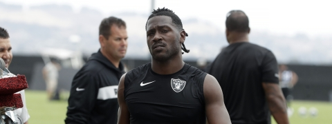 In this Aug. 20, 2019 photo, Oakland Raiders' Antonio Brown walks off the field after NFL football practice in Alameda, Calif. Coach Jon Gruden says star receiver Antonio Brown is back with the team and is expected to play the season opener on Monday.