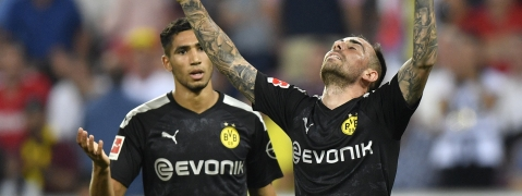 Paco Alcacer (right), shown celebrating a goal in a German Bundesliga match, will take the pitch as Spain begins qualifying Thursday (Martin Meissner)