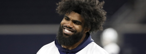 In this June 12, 2019, file photo, Dallas Cowboys running back Ezekiel Elliott smiles as he walks off the field after participating in drills at the team's NFL football training facility in Frisco, Texas.