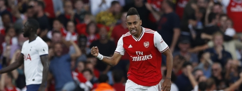 Arsenal's Pierre-Emerick Aubameyang, left, celebrates after scoring his side's second goal during their English Premier League soccer match between Arsenal and Tottenham Hotspur at the Emirates stadium in London, Sunday, Sept. 1, 2019.