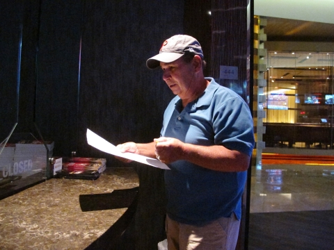 n this Sept. 4, 2019 photo, Andy Lanni of Oceanview, N.J. checks the odds at the sports book in the Borgata casino in Atlantic City, N.J. As the second NFL season begins following a U.S. Supreme Court decision clearing the way for legal sports betting, the industry is growing larger and ever-more mobile in the U.S. (AP Photo/Wayne Parry)
