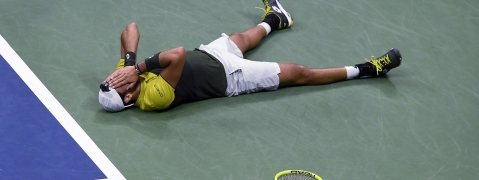 Matteo Berrettini, of Italy, falls to the court after winning the fifth set tie break for victory against Gael Monfils, of France, during the quarterfinals of the U.S. Open tennis championships Wednesday, Sept. 4, 2019, in New York. (AP Photo/Sarah Stier)