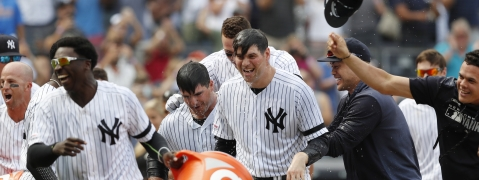 New York Yankees teammates celebrate with the Mike Ford, third from left, after dousing him with a sports drink Sunday, Sept. 1, 2019, in a baseball game in New York. Ford hit a ninth-inning, pinch-hit, walk-off home run in the Yankees' 5-4 win over the Oakland Athletics.