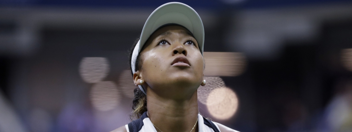 Naomi Osaka, of Japan, looks up at the score board during her match against Belinda Bencic, of Switzerland, in the fourth round of the US Open tennis championships Monday, Sept. 2, 2019, in New York.