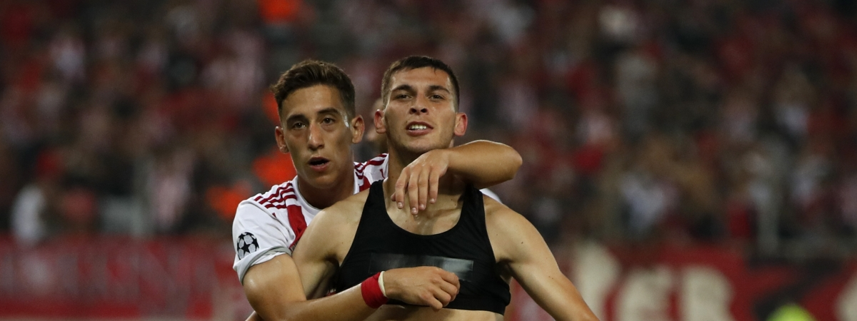 In this August 2019 file photo, Olympiakos' Lazar Randelovic, right, celebrates after scoring his side's third goal during the Champions League qualifying playoff first leg soccer match between Olympiakos and Krasnodar at Georgios Karaiskakis stadium in Piraeus port.