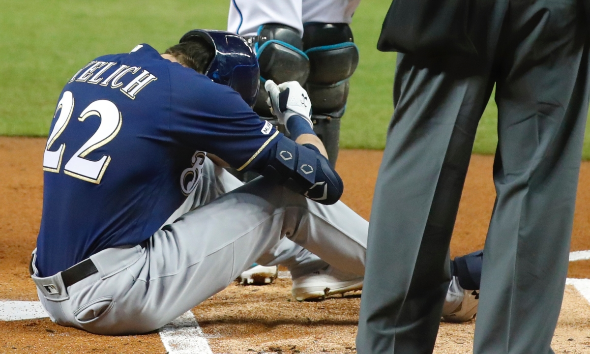 MLB injury news: Brewers star Christian Yelich fouls ball off leg, limps out of game against Marlins