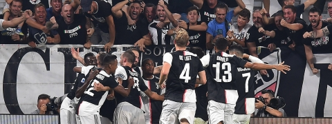 Juventus' Gonzalo Higuain, center left, celebrates scoring with his teammates during the Italian Serie A soccer match Juventus FC and SSC Napoli at the Allianz Stadium in Turin, Italy, Saturday Aug. 31, 2019. (Alessandro di Marco/ANSA via AP)