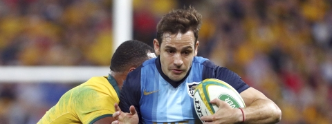 FILE - In this July 27, 2019, file photo, Argentina's Nicolas Sanchez, right, is tackled during a Rugby Championship match between Australia and Argentina in Brisbane, Australia. While Argentina has strength in depth and a powerful pack it clearly must finish better to have a chance of reaching a first Rugby World Cup final. (AP Photo/Tertius Pickard, File)