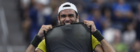Matteo Berrettini, of Italy, bites his shirt after defeating Andrey Rublev, of Russia, during the fourth round of the US Open tennis championships Monday, Sept. 2, 2019, in New York. (AP Photo/Sarah Stier)