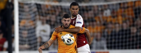 Wolverhampton Wanderers' Patrick Cutrone, front, battles for the ball with Sporting Braga's Pablo Santos during the Europa League Group K soccer match between Wolverhampton Wanderers and Sporting Braga at the Molineux Stadium in Wolverhampton, England on Sept. 19, 2019.