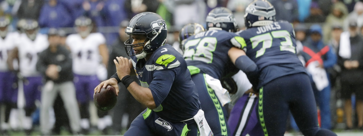 Seattle Seahawks quarterback Russell Wilson scrambles during the first half of an NFL football game against the Baltimore Ravens, Sunday, Oct. 20, 2019, in Seattle.