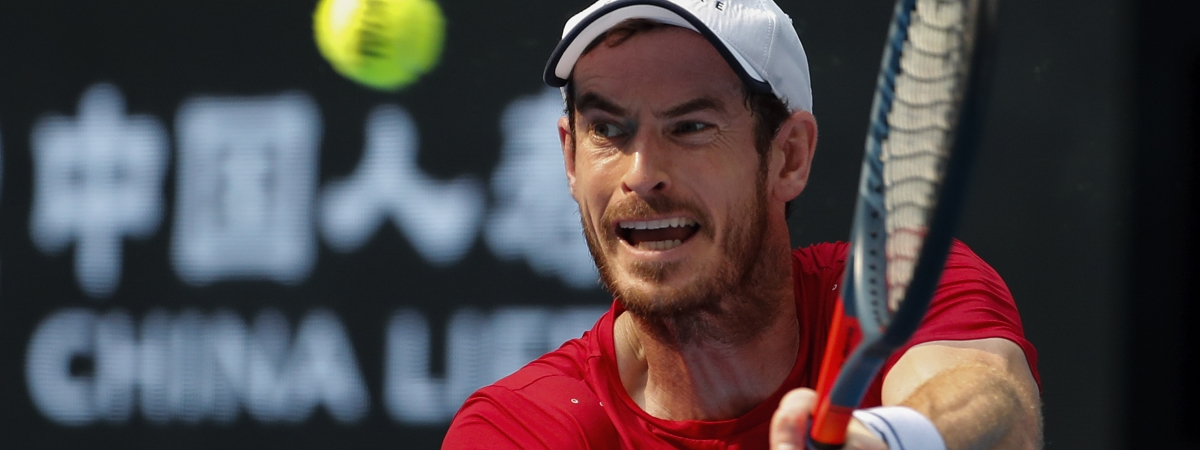 Andy Murray of Britain hits a return shot against his compatriot Cameron Norrie during their second round of the men's singles match in the China Open tennis tournament at the Diamond Court in Beijing, Wednesday, Oct. 2, 2019.