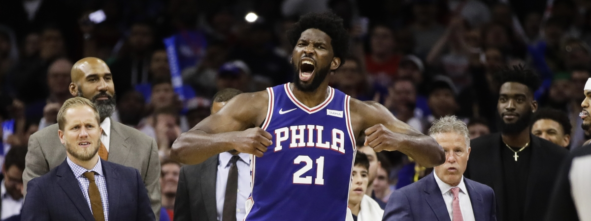 Philadelphia 76ers' Joel Embiid reacts after it was announced that he and Minnesota Timberwolves' Karl-Anthony Towns were ejected, during the second half of an NBA basketball game Wednesday, Oct. 30, 2019, in Philadelphia.
