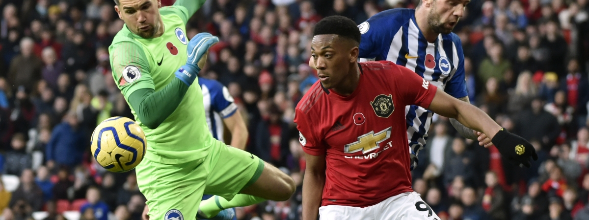 Brighton's goalkeeper Mathew Ryan, left, makes a save in front of Manchester United's Anthony Martial during the English Premier League soccer match between Manchester United and Brighton and Hove Albion, at the Old Trafford stadium in Manchester, England, Sunday, Nov. 10, 2019.