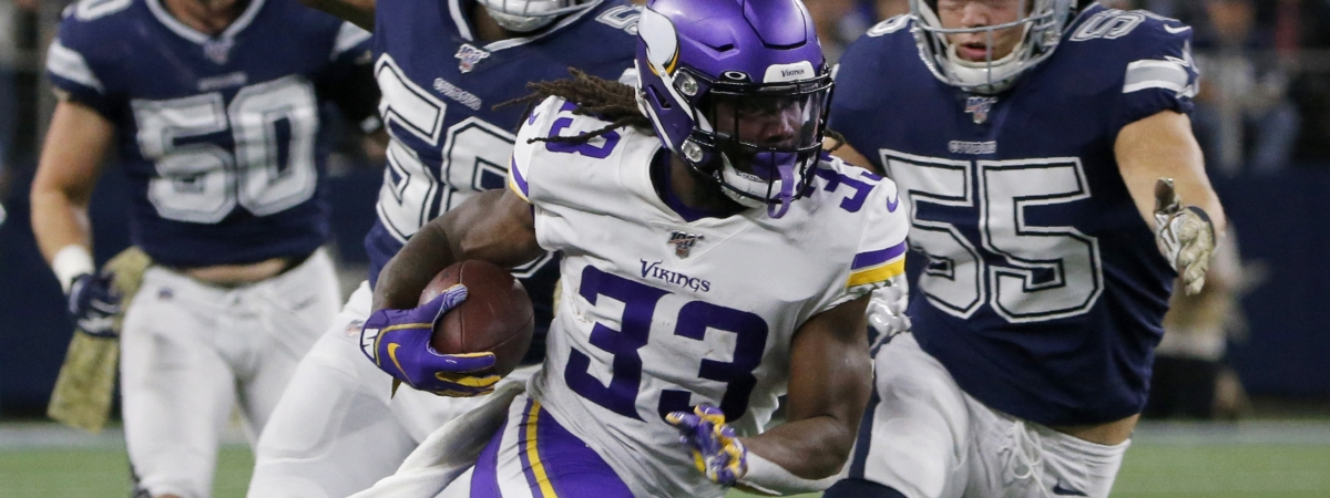 In this Nov. 10, 2019 photo, Minnesota Vikings running back Dalvin Cook (33) runs the ball as Dallas Cowboys' Robert Quinn (58) and Leighton Vander Esch (55) give chase during the first half of an NFL football game in Arlington, Texas. Cook is in position to win his first NFL rushing title after two injury-plagued seasons, which could also help him in the AP MVP voting.